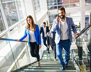 296x223-ca-business-people-walking-up-stairs-cauc