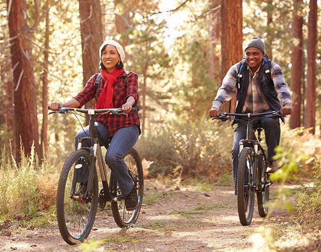 couple biking on trail