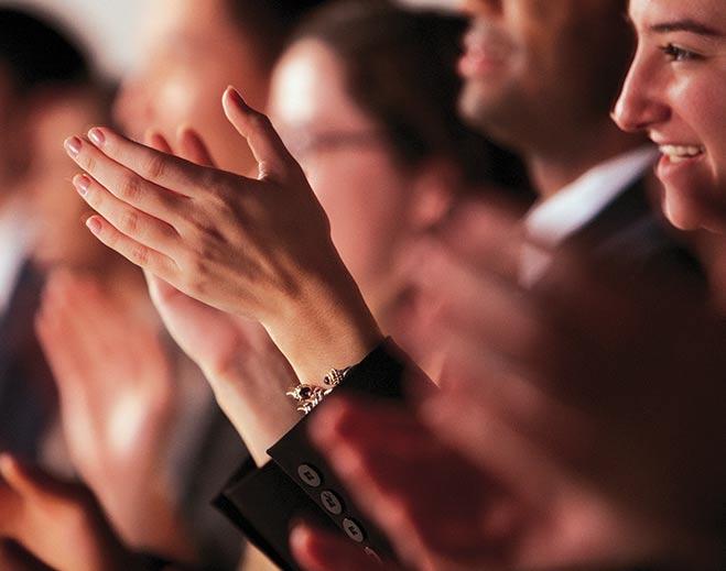 award-executives-applauding-woman