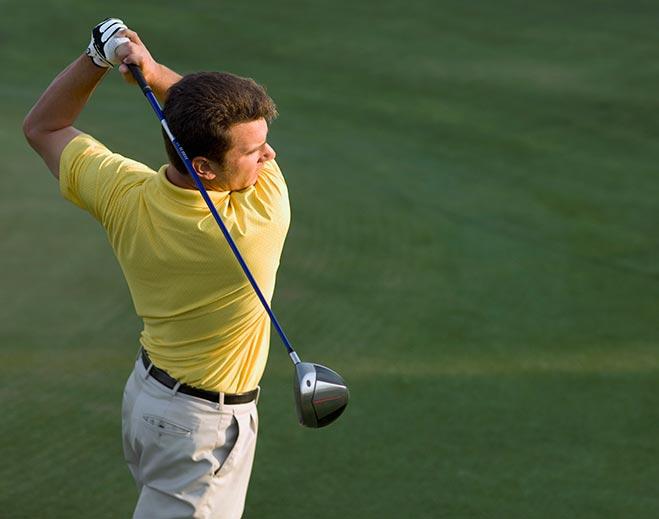 golfer-swinging-club