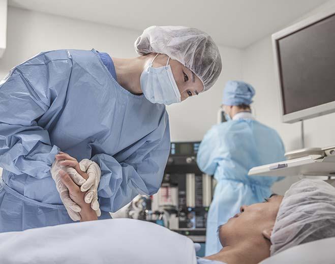 surgeon-comforting-patient