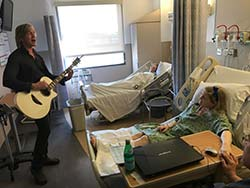 David Victor performing for patients
